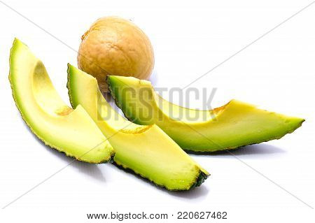 Avocado (Persea americana, alligator pear) slices with a stone isolated on white background