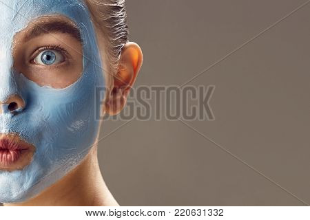 Spa Woman Applying Mask For Face And Is Surprised