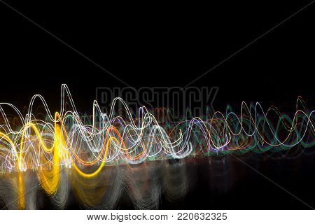 Abstract Light Lines On Black Background. Light Trails Against Dark Background.