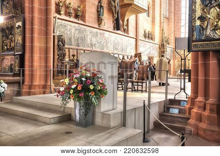 FRANKFURT AM MAIN, GERMANY - May 07,2014: Imperial cathedral of saint Bartholomew. A pastor reads prayer