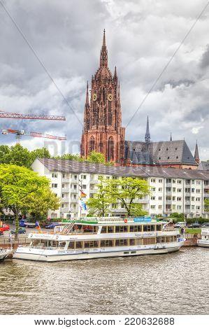 FRANKFURT AM MAIN, GERMANY - May 07,2014: City landscape. Main river embankment and bridge