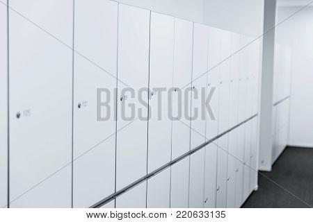 locker room in hostel clean white interior
