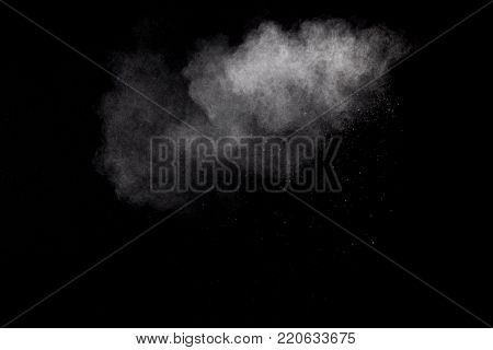 Freeze Motion Explosion Of White Dust On  Black Background. By Throwing Talcum Powder Out Of Hand. S