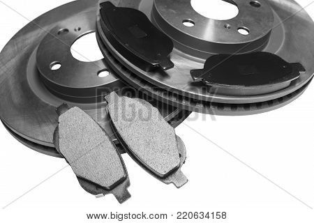 brake pads and car disks with shallow depth of field on a white background