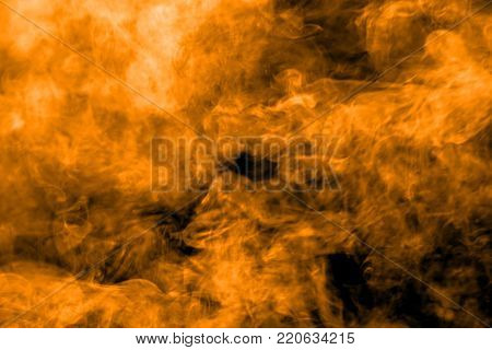 abstract orange dust explosion on  black background. abstract orange powder splattered on black background, Freeze motion of orange powder splash.