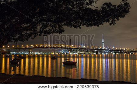 Harbour Bridge and Auckland city by night , New Zealand