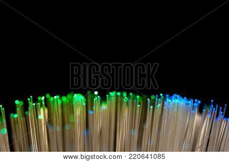 Green , blue optical fibre close up macro shot for background image , isolated on black.