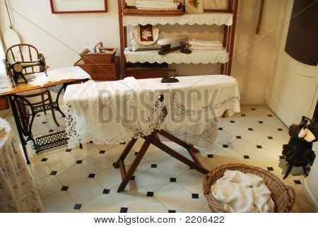 Old Fashioned Ironing Board And Laundry Room