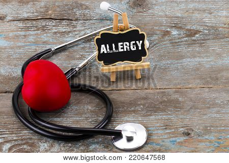 A Board With The Word Allergy And Stethoscope. The Concept Of Medicine. A Board With The Word Allerg