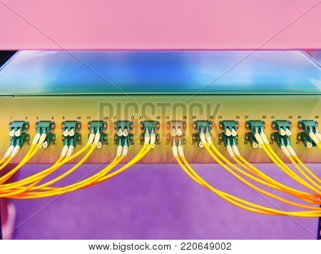 fiber optical cables connected to an optic ports
