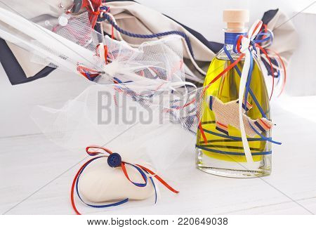 greek Orthodox christening objects - baptism oil, soap and candles
