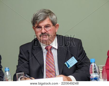 MOSCOW, RUSSIA - NOV 30, 2005: American computer scientist and author of the data warehouse concept Bill Inmon  makes speech at Business Intelligence  forum in Moscow, Russia on Nov 30, 2005.