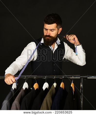 Businessman In Classic Vest Measures Jacket Size With Measuring Tape.