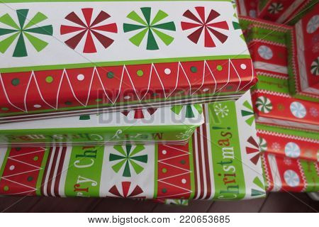 close-up of a stack of colorful wrapped Christmas presents