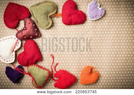 Valentine's Day. Colorful knitted hearts on a vintage background in polka dots. Red heart. Valentines day. Heart pendant. Valentine cards. Eighth of March. International Women's Day.