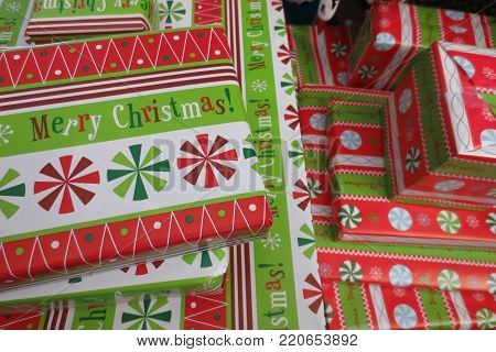 close-up of a pile of colorful wrapped Christmas presents