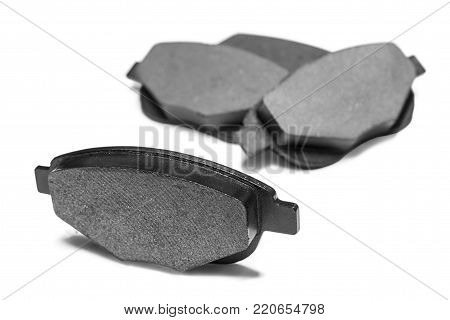 brake pads with shallow depth of field on a white background