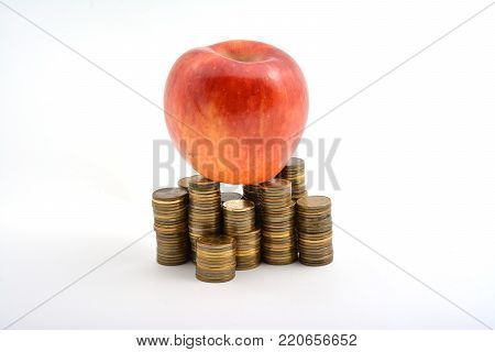 Red Apple With Coins Isolated On White Background