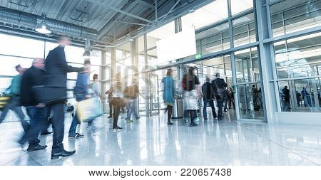 crowd of business people rushing in a modern hall. ideal for websites and magazines layouts