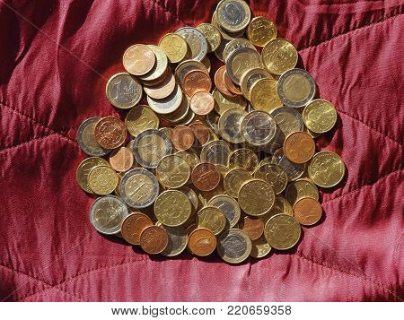 Euro Coins, European Union Over Red Velvet Background
