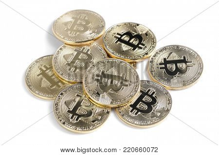 Macro view of shiny Bitcoin souvenire coins heap, isolated on white