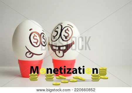monetization concept. funny and funny eggs with a face. satire. eyes like a dollar