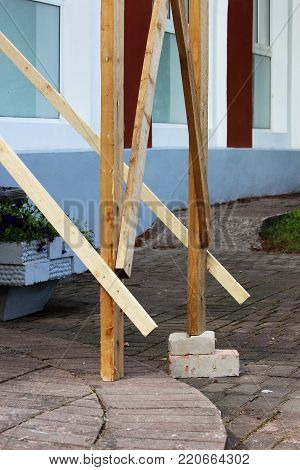 wooden scaffolding with bricks, laid under the foot for the worker plasterer. reportage. safety violation