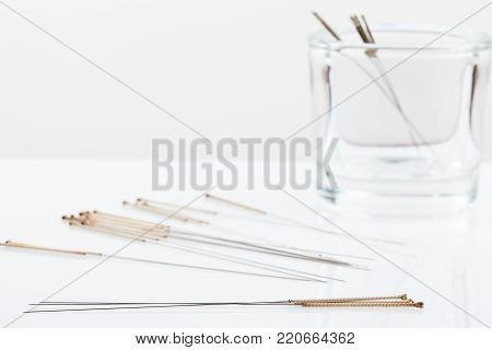 Silver needles for traditional Chinese medicine acupuncture. Close-up. There is some free space for your text or sign.