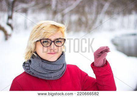 girl with blond hair and glasses gestures blah blah blah