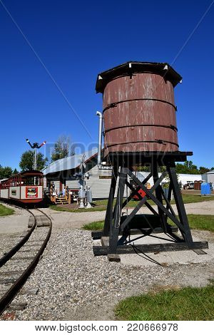 DALTON,  MINNESOTA, Sept 8, 2017: A wooden water tank for steam locomotives is located by the train tracks and depot at the at the annual Dalton Threshing Bee farm show in Dalton held each 2nd full weekend in September where 1000's attend.