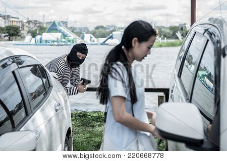 Thief is trying to steal the car at the public parking