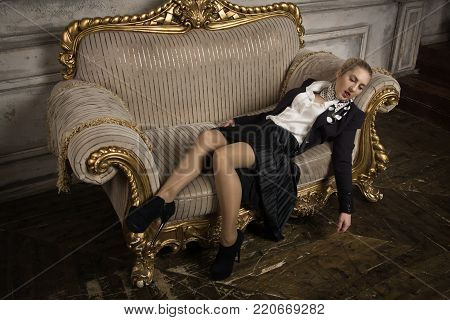 Strangled Business Woman Lying On The Couch (imitation)