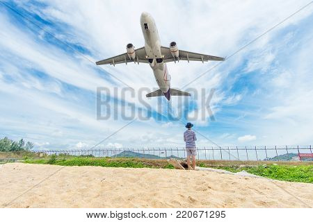 PHUKET, Thailand - October 23, 2017 : Thai airways airplane flying take off at Phuket International Airport, Mai Khao Beach, Phuket province, Southern of Thailand.