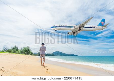 PHUKET, Thailand - October 23, 2017 : China Southern Airbus 330-300 airplane flying landing at Phuket International Airport, Mai Khao Beach, Phuket province, Southern of Thailand.