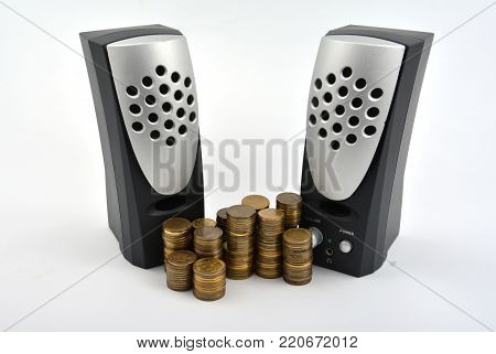 Speakers with coins isolated on white background