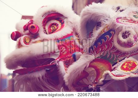 Happy Chinese New Year good luck image of lion dance costume traditional New Year's activity for good luck to business owners closeup selective focus with copy space for New Year's wishes and copy space