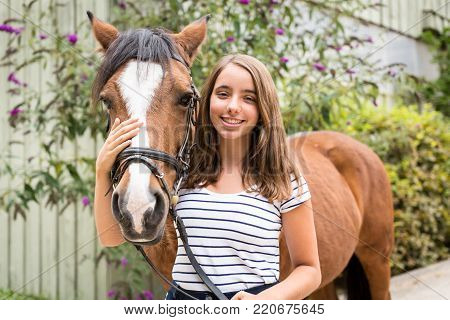 Teenage Girl With Her Pony on a horse ranch