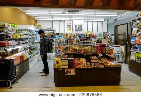 Nagoya, Japan - Dec 3, 2016. People at a convenience store in Nagoya, Japan. Nagoya is Japan third-largest incorporated city and the fourth most populous urban area.