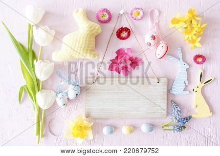 Wooden Sign With Copy Space For Advertisement. Easter Flat Lay With Decoration Like Easter Bunny And Easter Egg. Spring Flower Blossoms Like Tulipa, Daisy And Narcissus.
