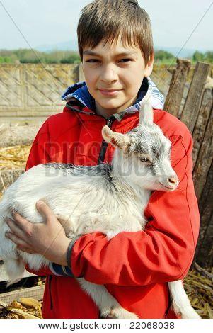Teenage Boy With Little Goat