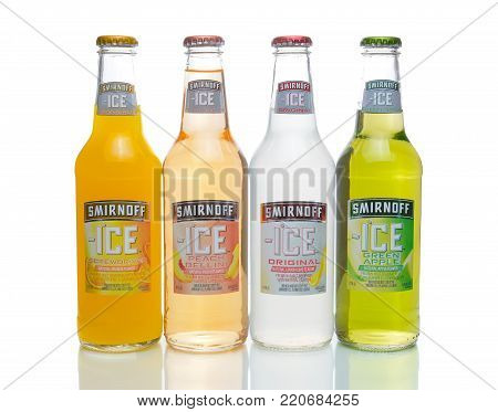 IRVINE, CA - JANUARY 4, 2018: Smirnoff Ice four bottles. The Original Premium Flavored Malt Beverage with a delightfully crisp, citrus taste.