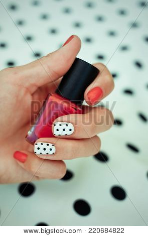 Manicure - Beauty treatment photo of nice manicured woman fingernails. Very nice feminine nail art with nice red, white and black nail polish poster