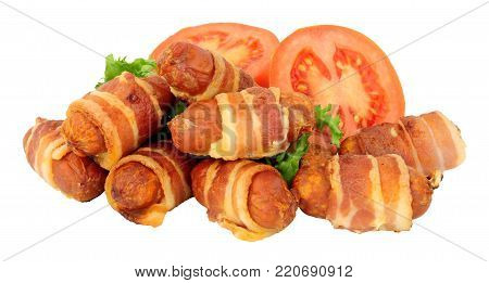 Group of small chorizo sausage pigs in blankets isolated on a white background