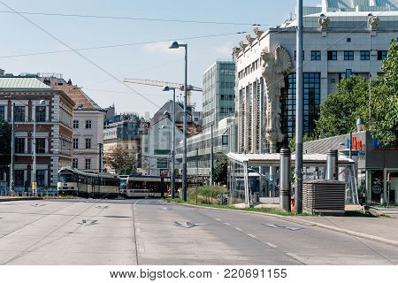 Vienna,  Austria - August 17, 2017: Tramway in Karlsplatz in Vienna.  It is one of the most frequented and best connected transportation hubs in Vienna.