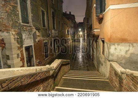 empty street by rainy night in Venice, Italy