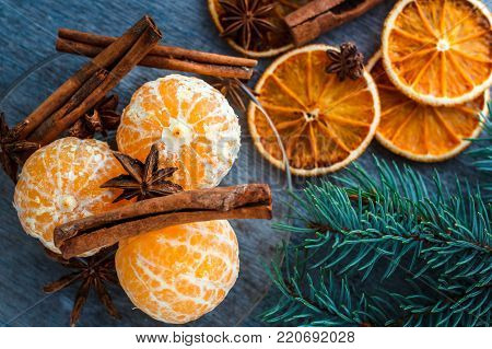 Mandarins, Dried Oranges, Anise And Cinnamon Sticks On A Wooden Table