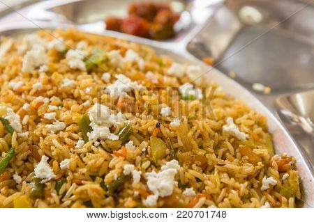 plate of biriyani rice in street restaurant, this menu is normal dish in north india. shadow depth of field