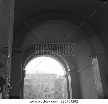 Arch in the old house. Monochrome. Old architecture. Historic architecture.Arch.