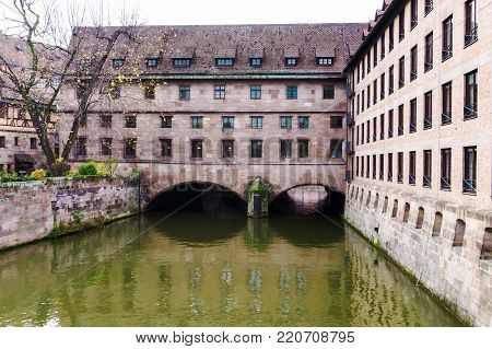 Heilig-Geist-Spital or Hospital of the Holy Spirit, over the river Pegniz in the middle of the old town in Nuremberg, Bavaria, Germany