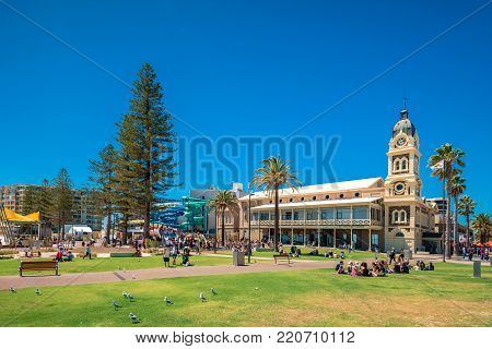 Adelaide, Australia - February 28, 2016: People relaxing in public park at Moseley Square in Glenelg on a bright summer day.